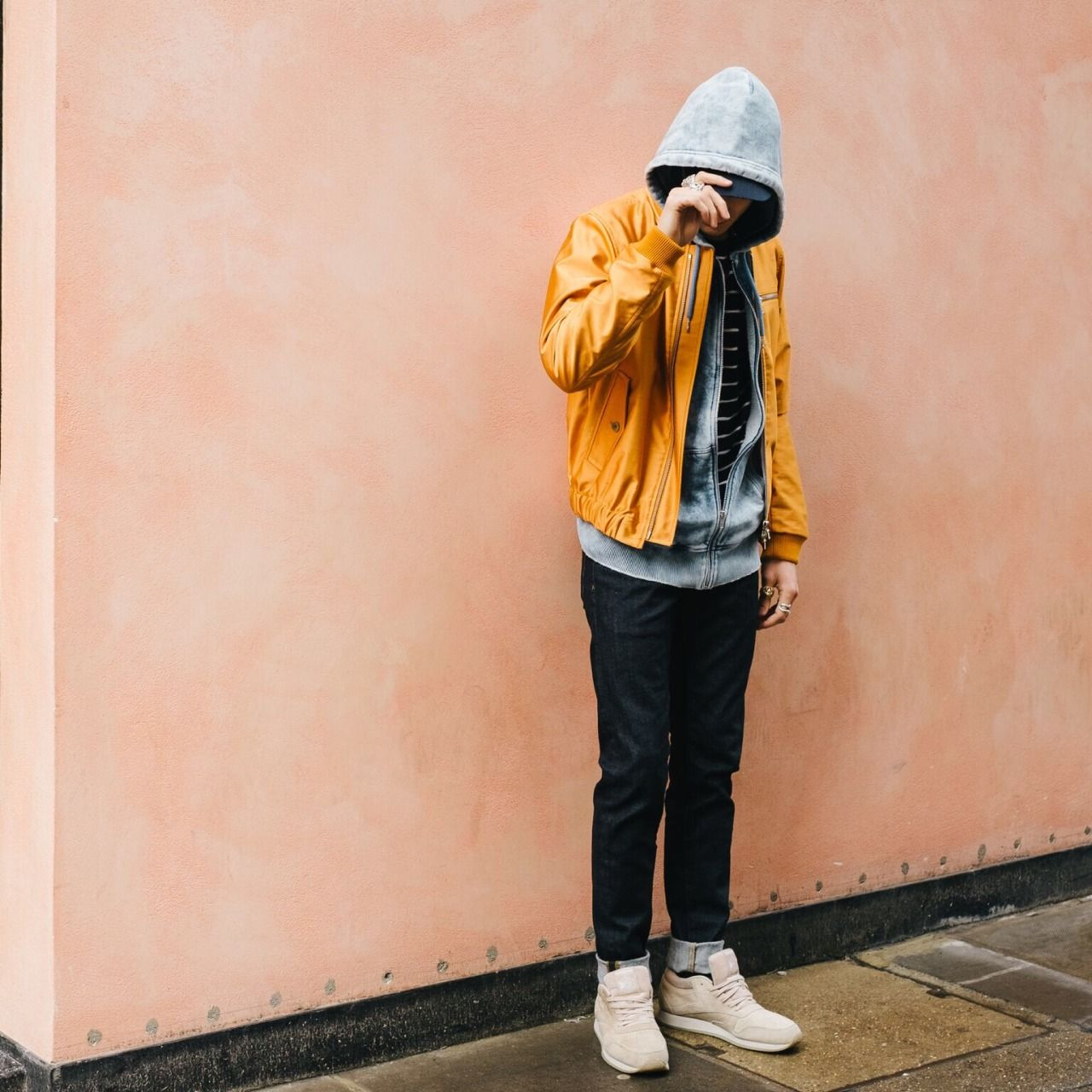 Menswear street style look featuring perfect layering with the stripe tee from River Island underneath the grey Diesel hoodie which are both complimenting the yellow statement  jacket from Dries Van Noten incredibly well. Outfit finished off with AG jeans and a pair of Reebok Classics.