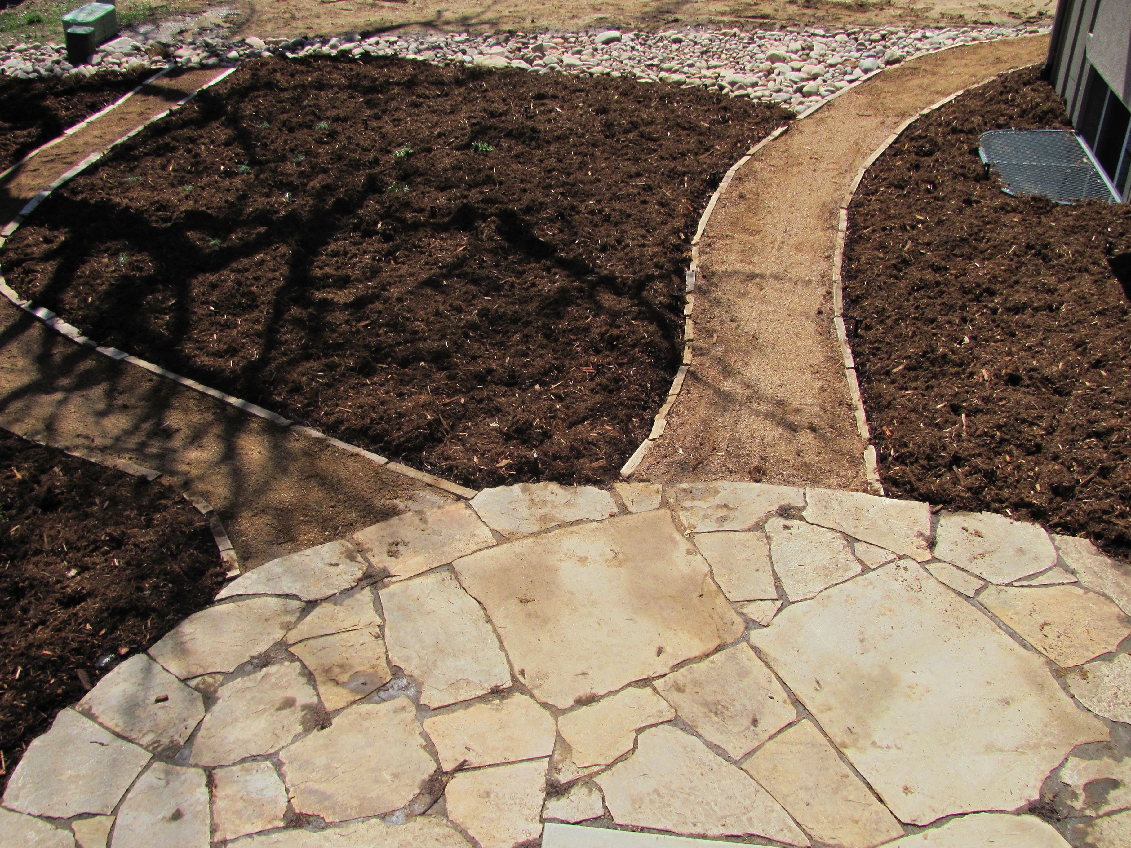 Colorado Buff Flagstone Patio and Stone Edged Walkway Installed By