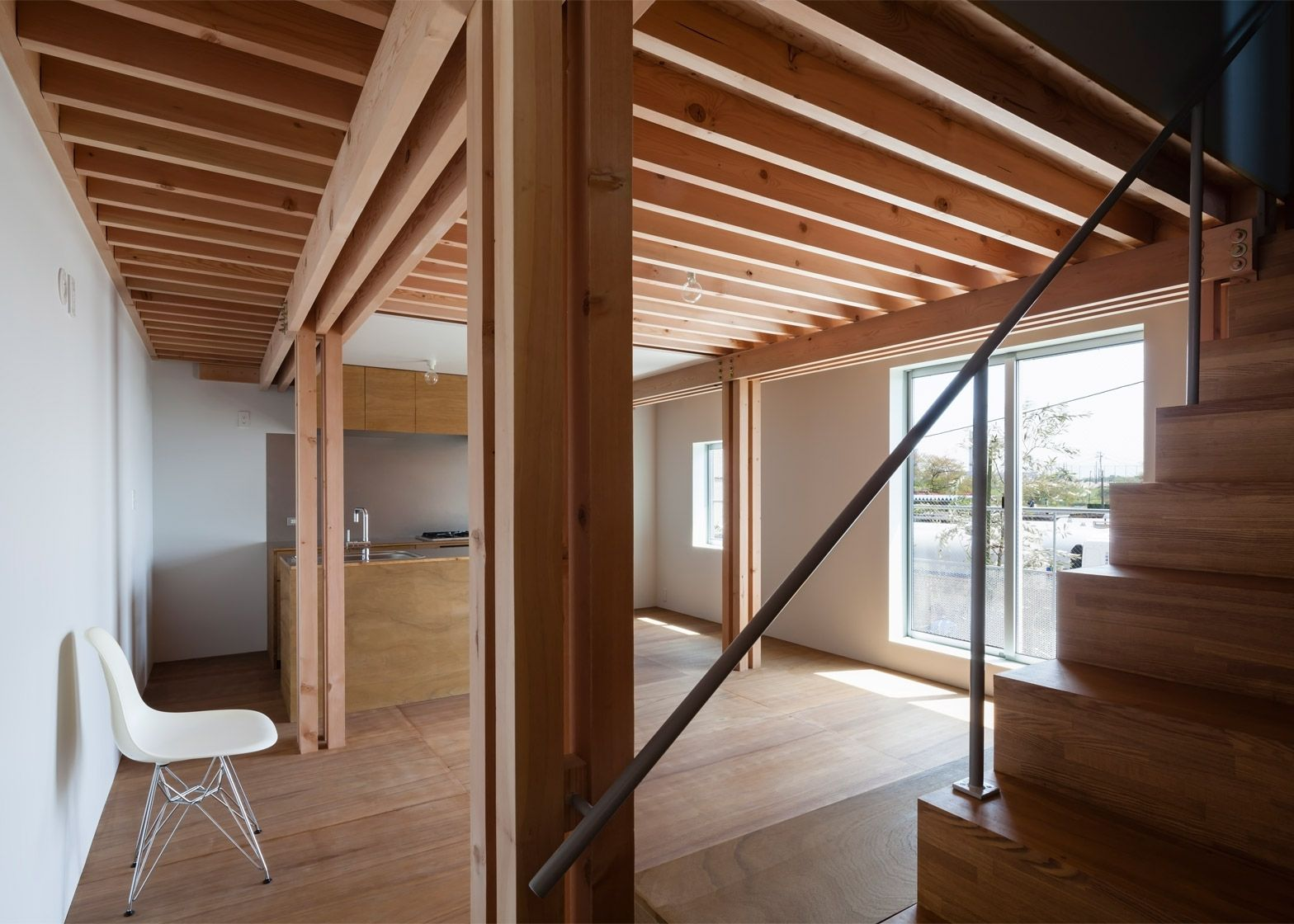 FT Architects 4 Columns house features a timber frame Columns