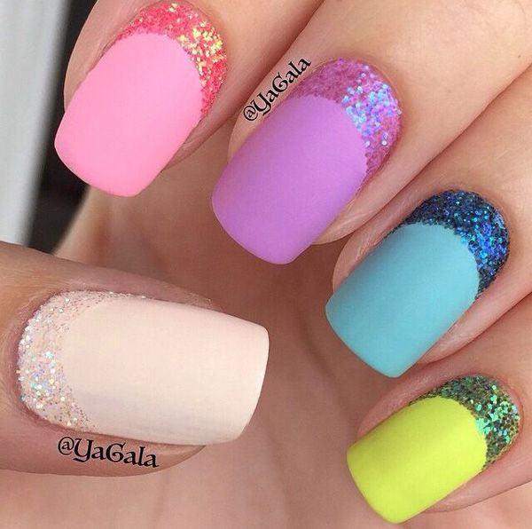 Amazingly color coded half moon glitter nail art where the glitter is concentrated on the cuticle part of the nails.