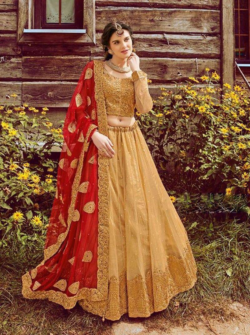 166c052c4d Designer Gold reception wear lehenga choli for punjabi bride with contrast  red dupatta