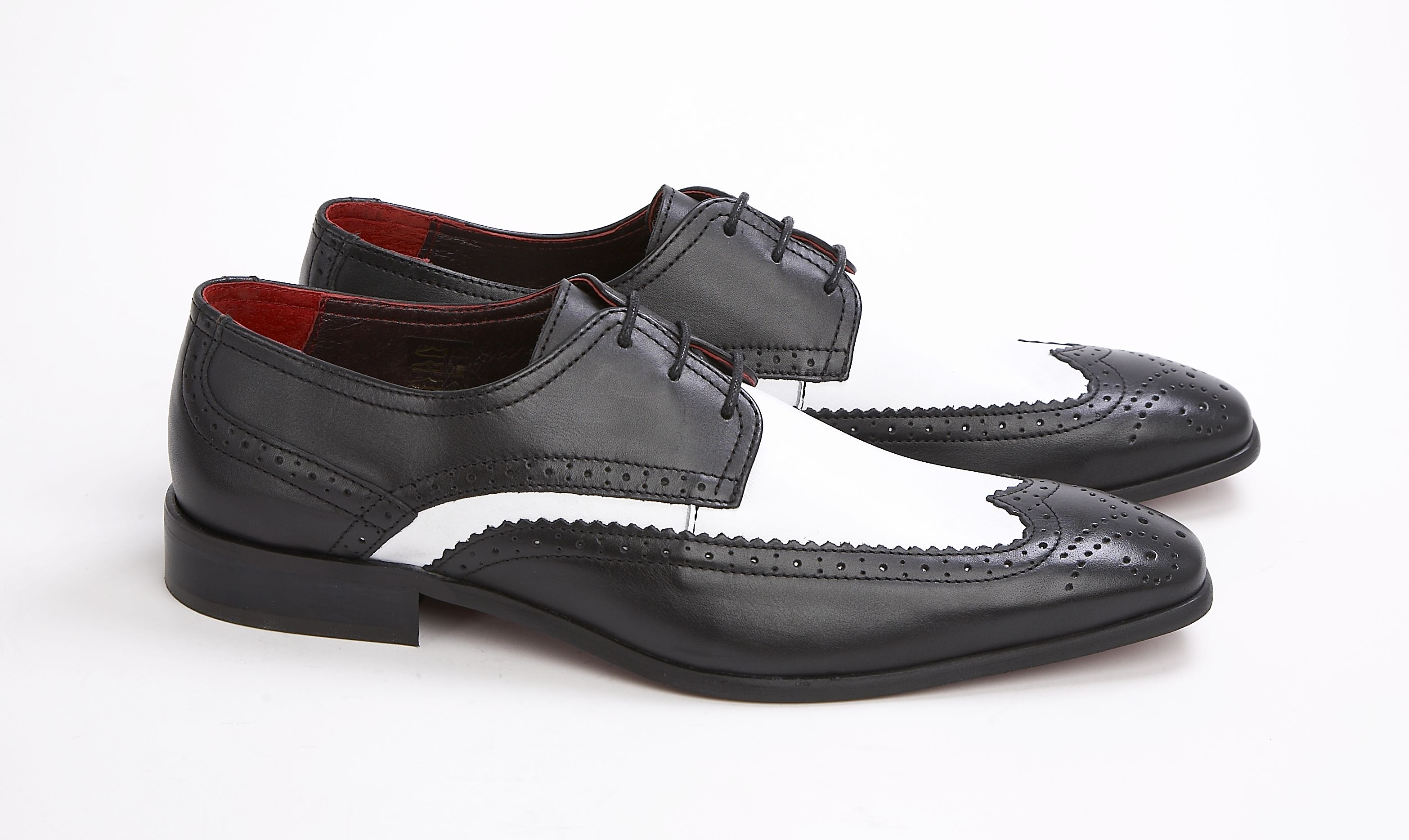 The Dekker £75.00    Classic 3 eyelet 2 tone brogue Construction: Leather upper - Leather linings and sock - Other materials sole  Colour: Black & White Smooth  Sizes available: 6-12