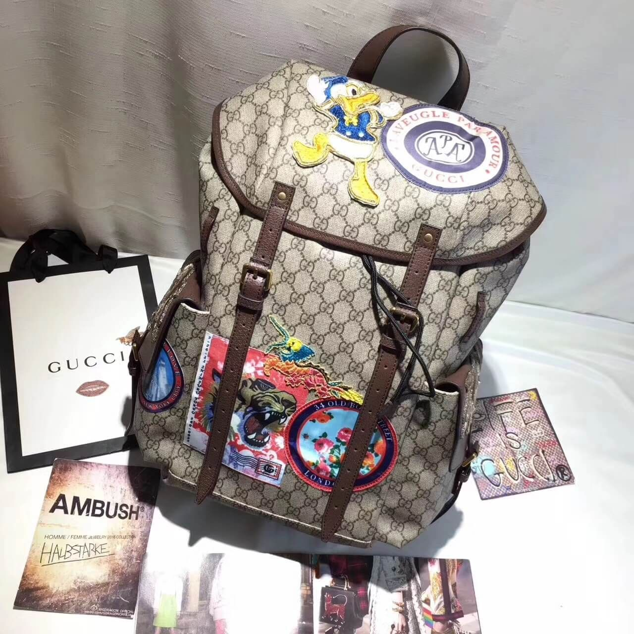 3e415970d2952 Gucci 460029 Soft GG Supreme Backpack with Donald Duck Appliqués 2017
