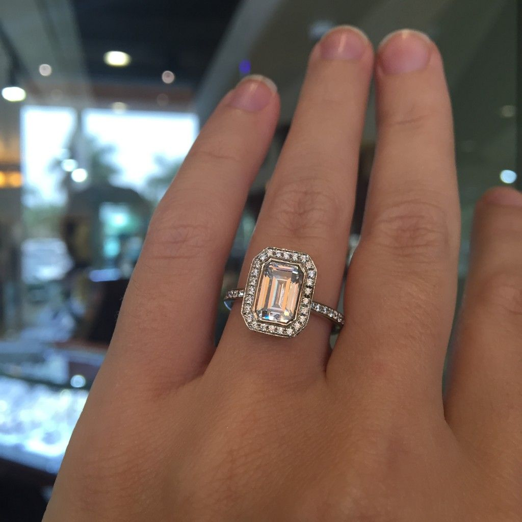 emerald wedding rings Completely unique A Jaffe emerald cut halo engagement ring