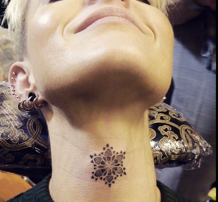 Such a cool placement snowflake tattoo on the throat neck for Adam reynolds neck tattoo