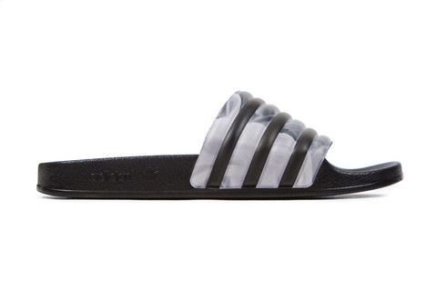 e146f10f8be0 Adidas Originals x Rita Ora Women s Adilette Slides - Core Black – Feature  Sneaker Boutique