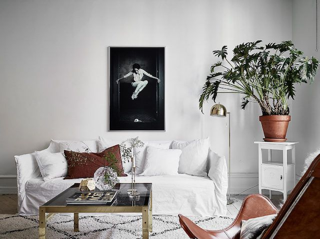 Ghost Sofa And Touches Of Cognac And Brass In A Swedish Sitting Room.