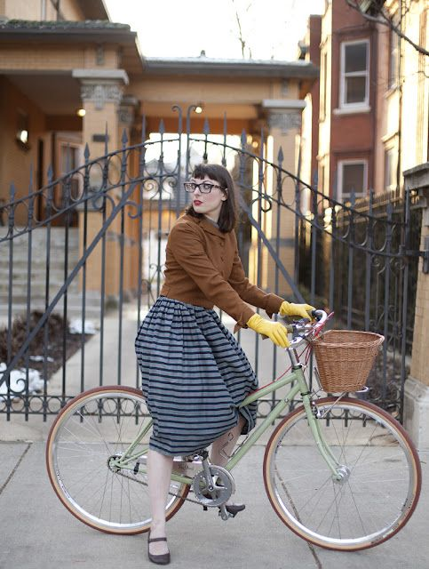 I want to be her! Of course, where would I go? And how would I ever remember to get my bangs trimmed in a timely fashion? Ok, I want to dream of having somewhere wonderful to go on a pretty bike while dressed super cool with great hair. Done!