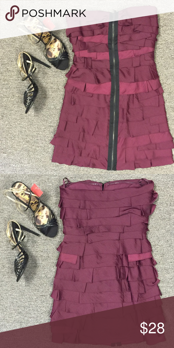 """BCBG maroon Ruffle Bodycon dress VGUC. Zips up the front. There is padding in the bust. Fits more like a size 2. Bust 32"""" Waist 26"""" Length 26"""" BCBGMaxAzria Dresses Strapless"""