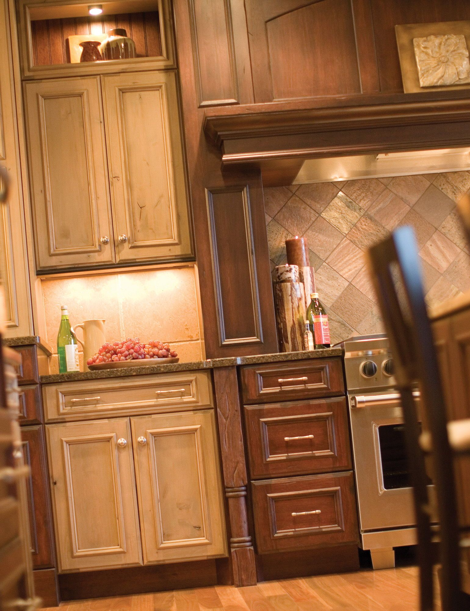 Mix it Up with 2 Tones of Stained Cabinets This elegant Wood Hood