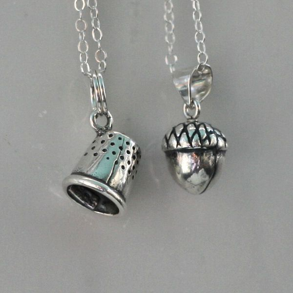Peter Pan & Wendy Kiss Thimble and Acorn Exchange  - Men - Women - Sweetheart - Lover - Sister - Best Friend (2 Necklaces) Sterling Silver. $62.00, via Etsy.