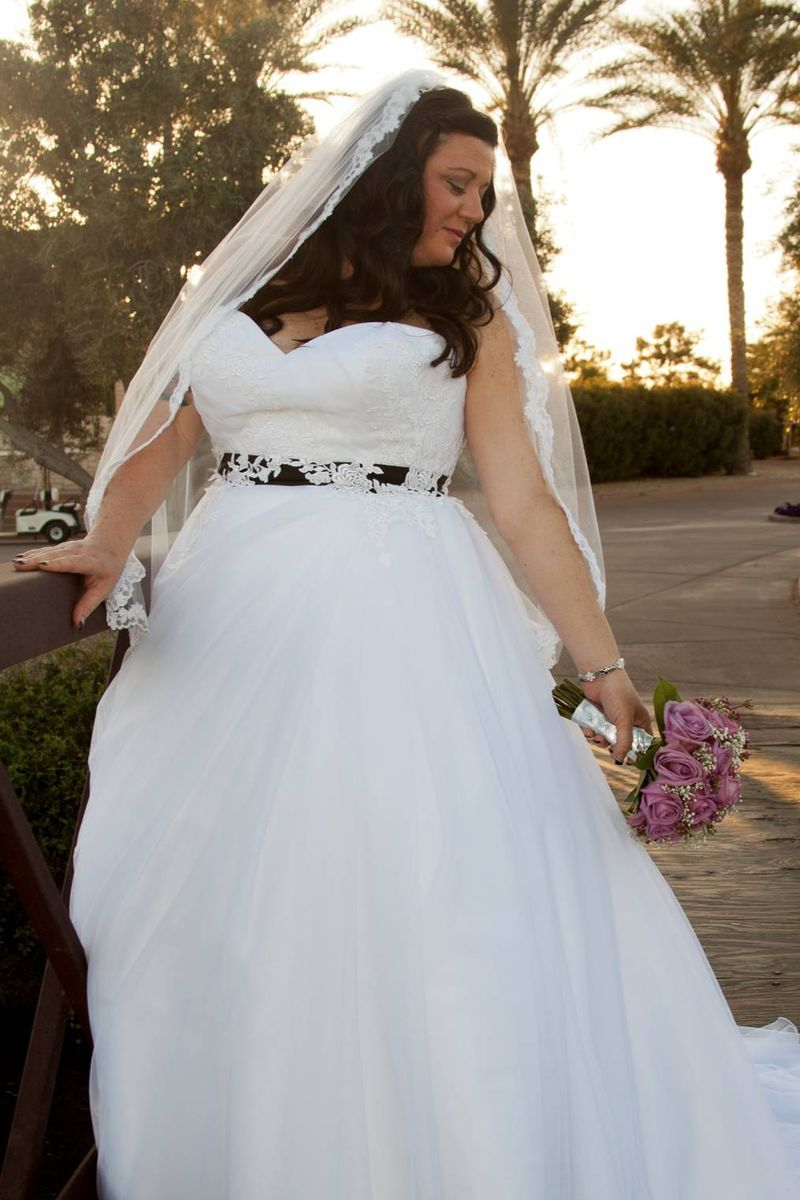 Stacie in a natural waist tulle ballgown. #strutbridal #plussize ...