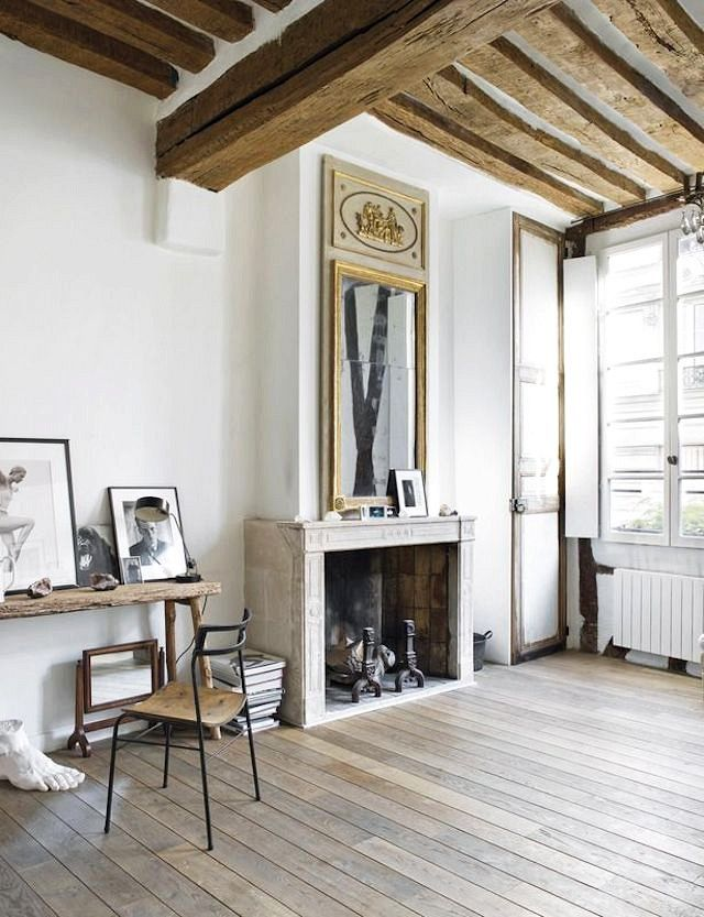 Perfection Fireplace Part - 42: Rustic Living Space With Exposed Wooden Beams, A Fireplace, And A Large  Vintage Mirror