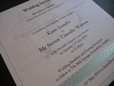 Birdcage theme Wedding invitations with spotty aqua ribbon