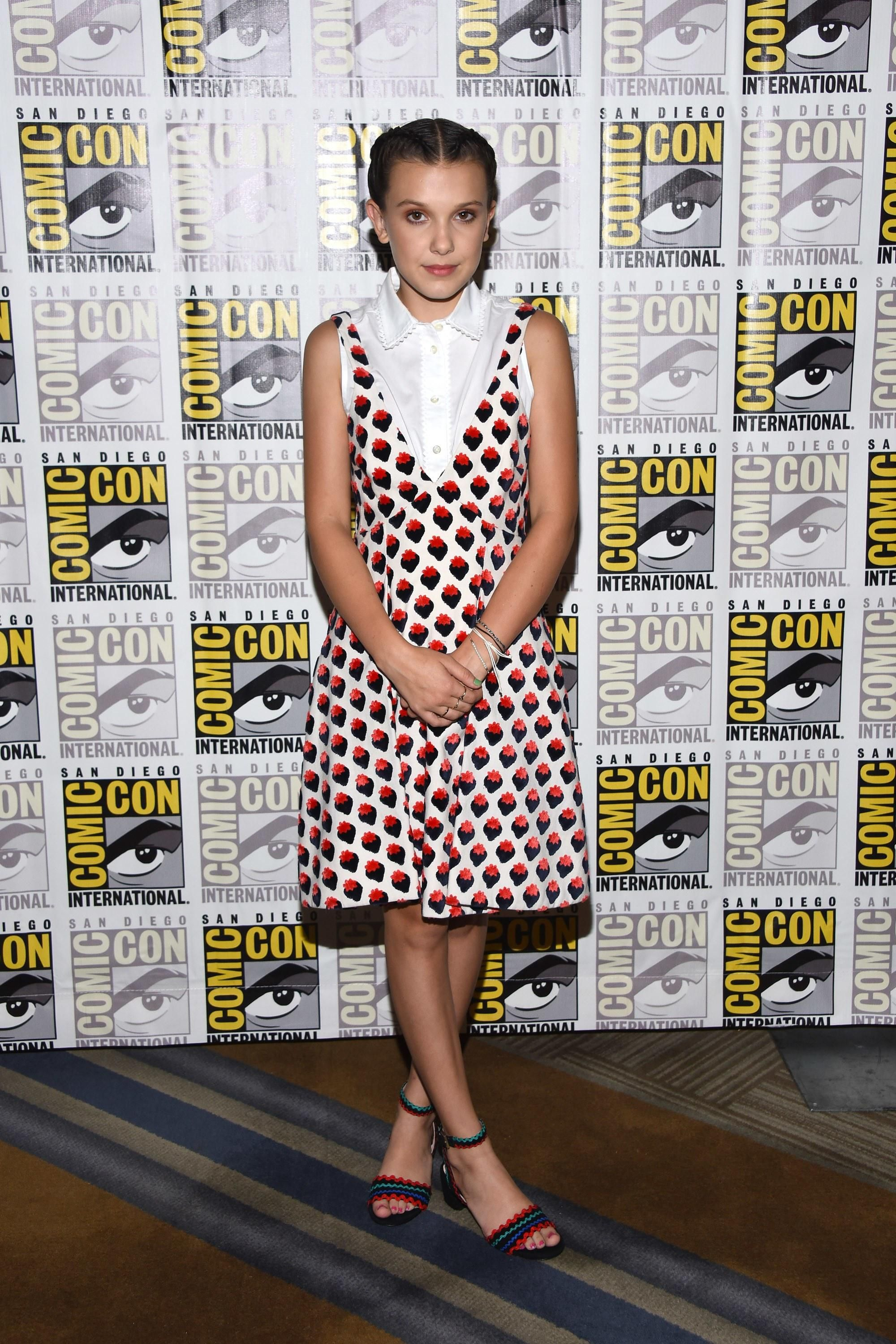 da4f5809c89 Stranger Things  Millie Bobby Brown wearing a Victoria Beckham mini dress  at Comic-Con 2017