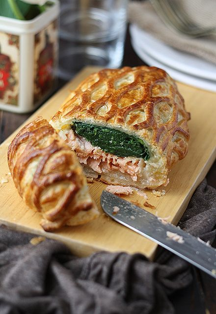Salmon en Croûte - crisp and buttery puff pastry enveloping a delicious salmon fillet with béchamel and spinach.  Very easy to make and will impress your guests!