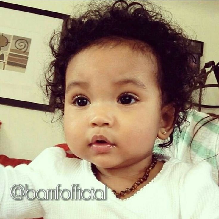 Beautiful Baby Girl With Chocolate Brown Eyes And Curly Hair