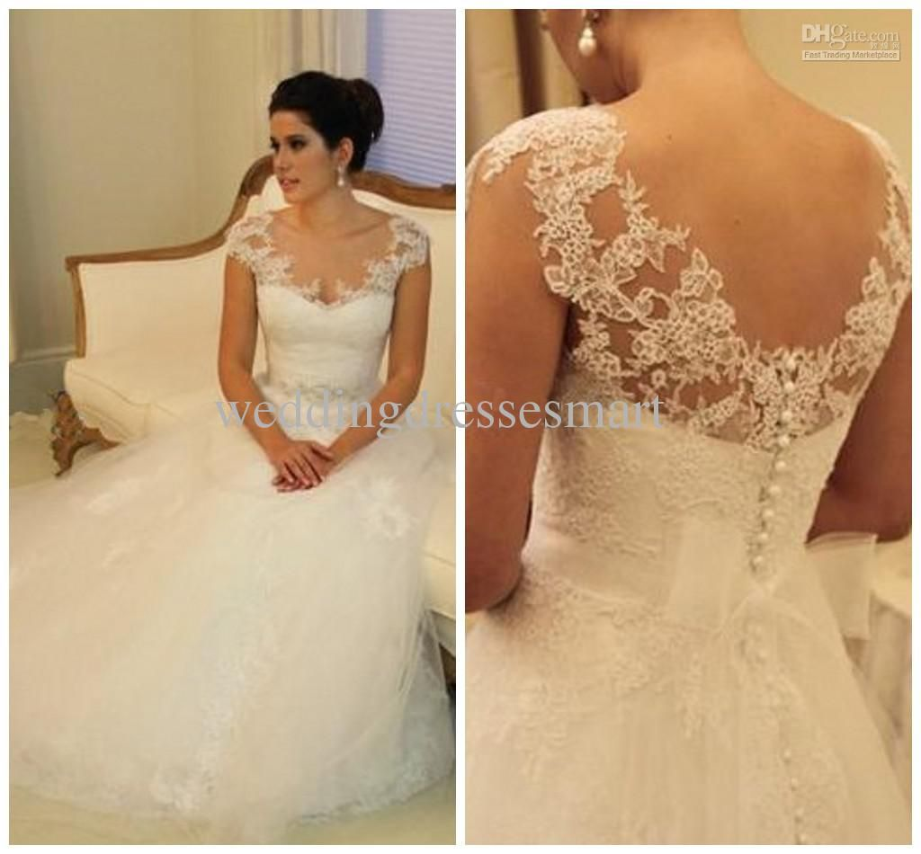 A line cap sleeve wedding dress  Ball Gown Sheer Cap Sleeves Wedding Dresses Sexy Covered Button