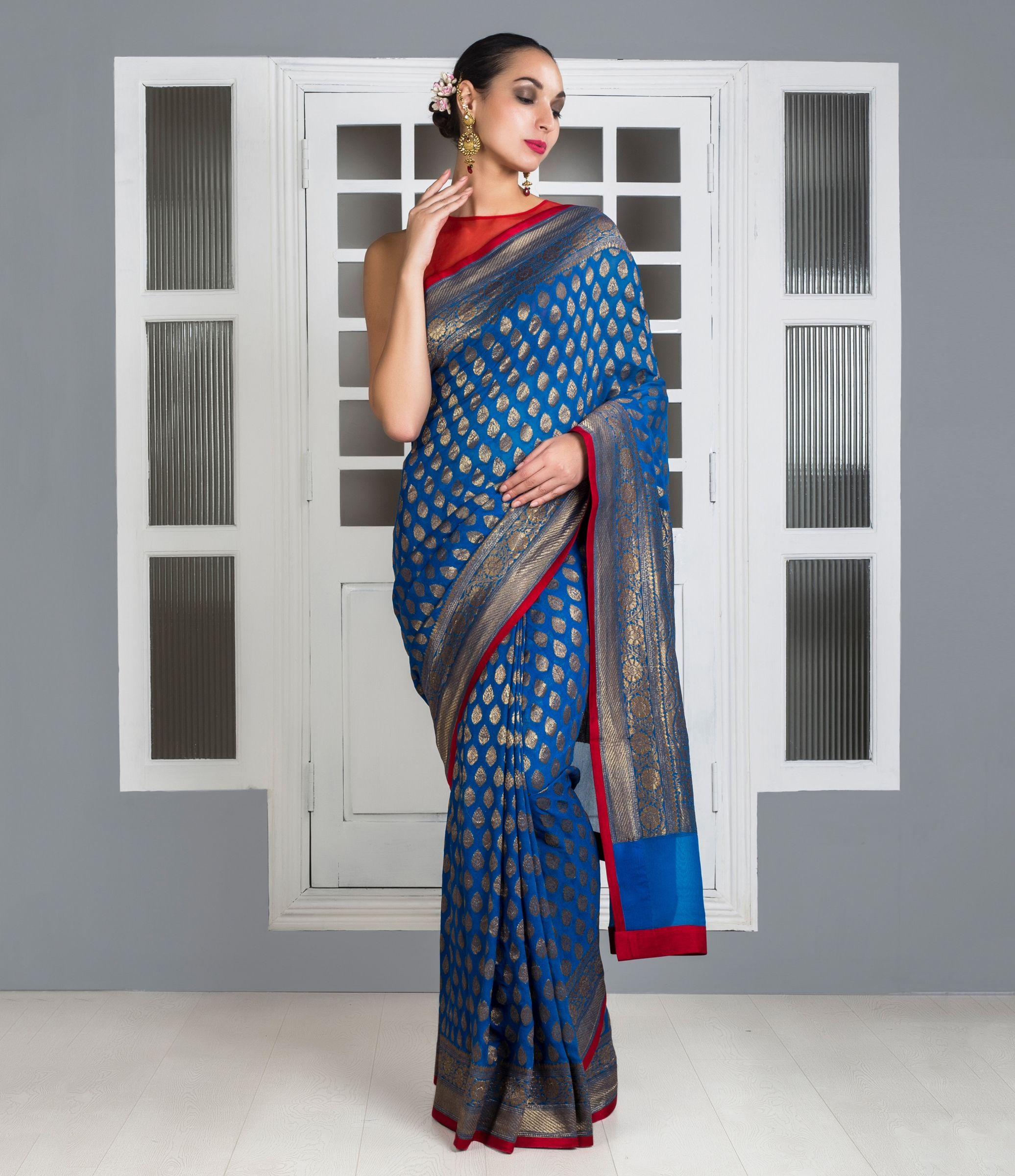 d1d6682916 This Ink blue antique zari Banrasi georgette saree has small antique zari  woven bootis all over