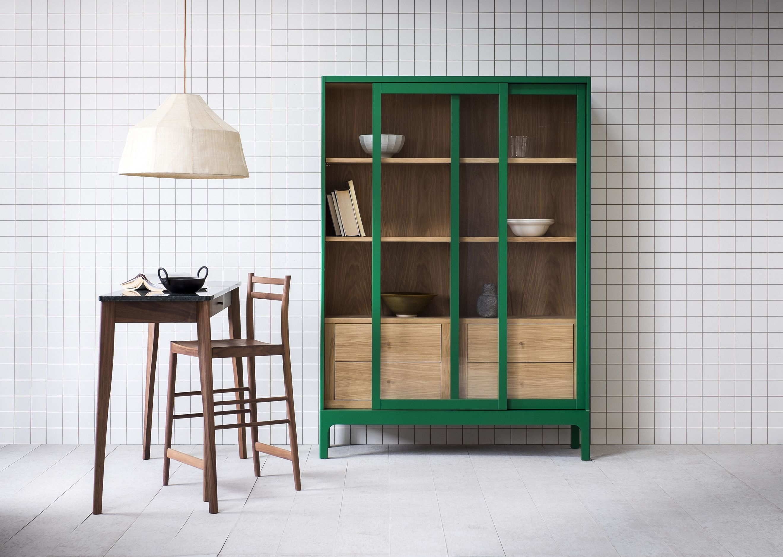 The Joyce cabinet has sliding glass fronted doors and a timber lined