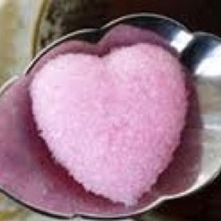 """Colored heart shaped sugar cubes are easy to make and fun to give. Just dye sugar with commercial food coloring, moisten with the smallest amount of water possible, press firmly into a """"dough"""" and cut with a small cookie cutter. Dry and share. A sweet gift for the tea lover."""