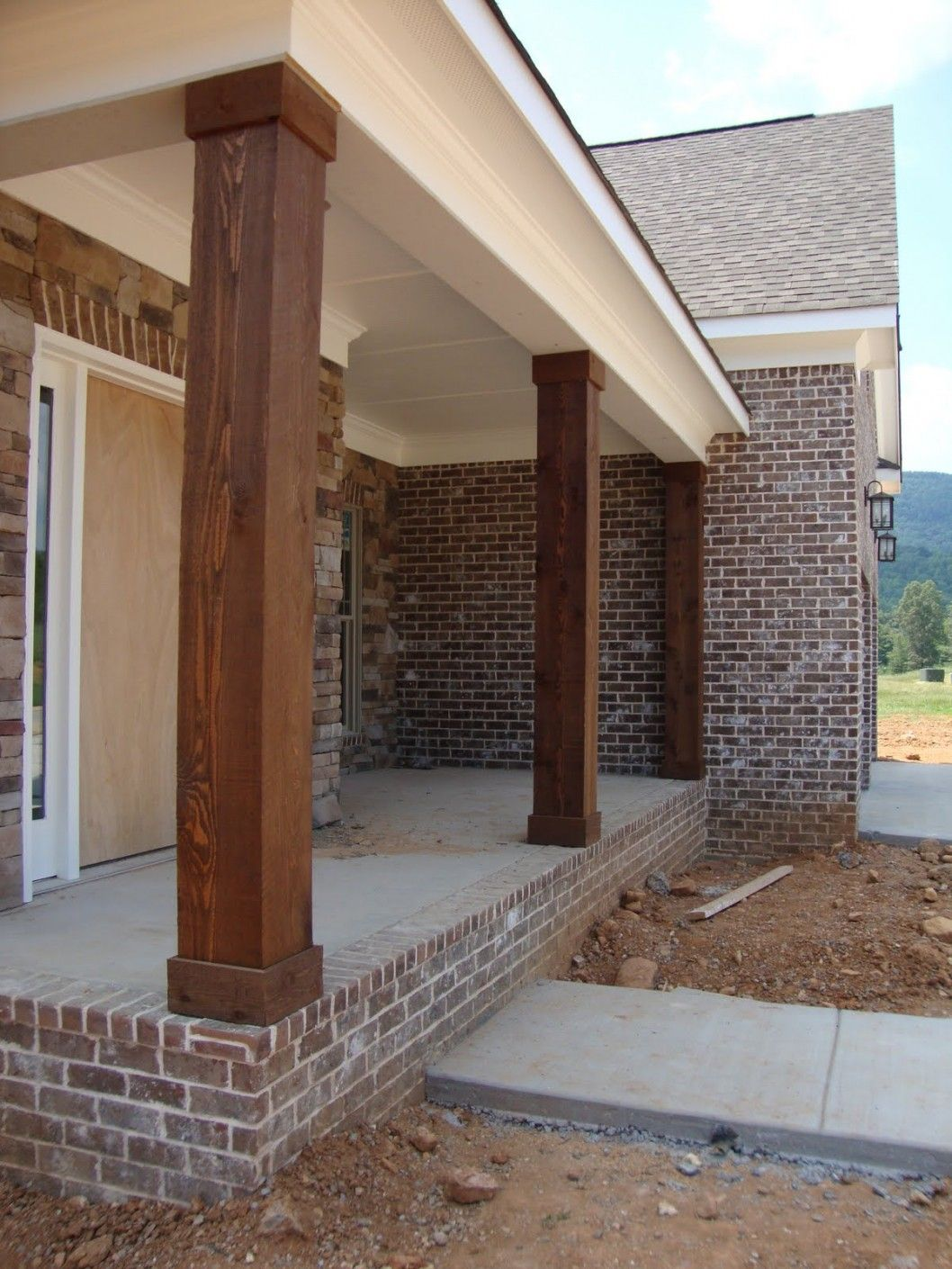 These Columns Instead Of The White Round Columns On Front Back Porches House Exterior Porch Columns Front Porch Columns