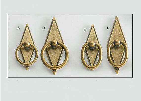 Cast Zinc Ring Pulls With An Antique Brass Finish And Diamond