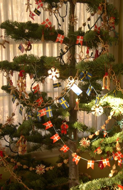 traditional Danish/Swedish tree, with straw ornaments, lights and