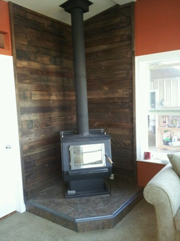 Wood Stove Design Ideas saveemail Pallet Wall Behind Wood Stove Basement Idea