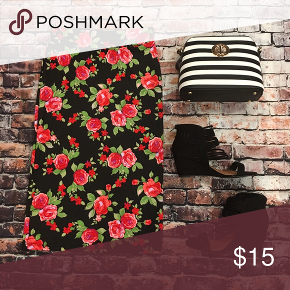 Black and red floral pencil skirt Floral stretchy pencil skirt. 89% polyester 9% Rayon 2% Spandex Skirts Pencil