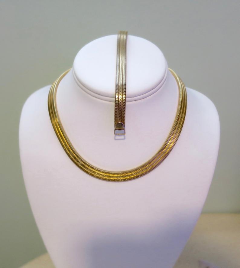 Vintage golden choker necklace and bracelet set.