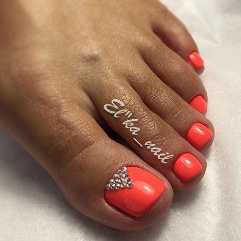 coral-orange toe nails nail