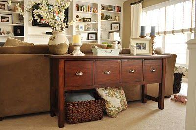 sofa table decor- i like the drawers for storage