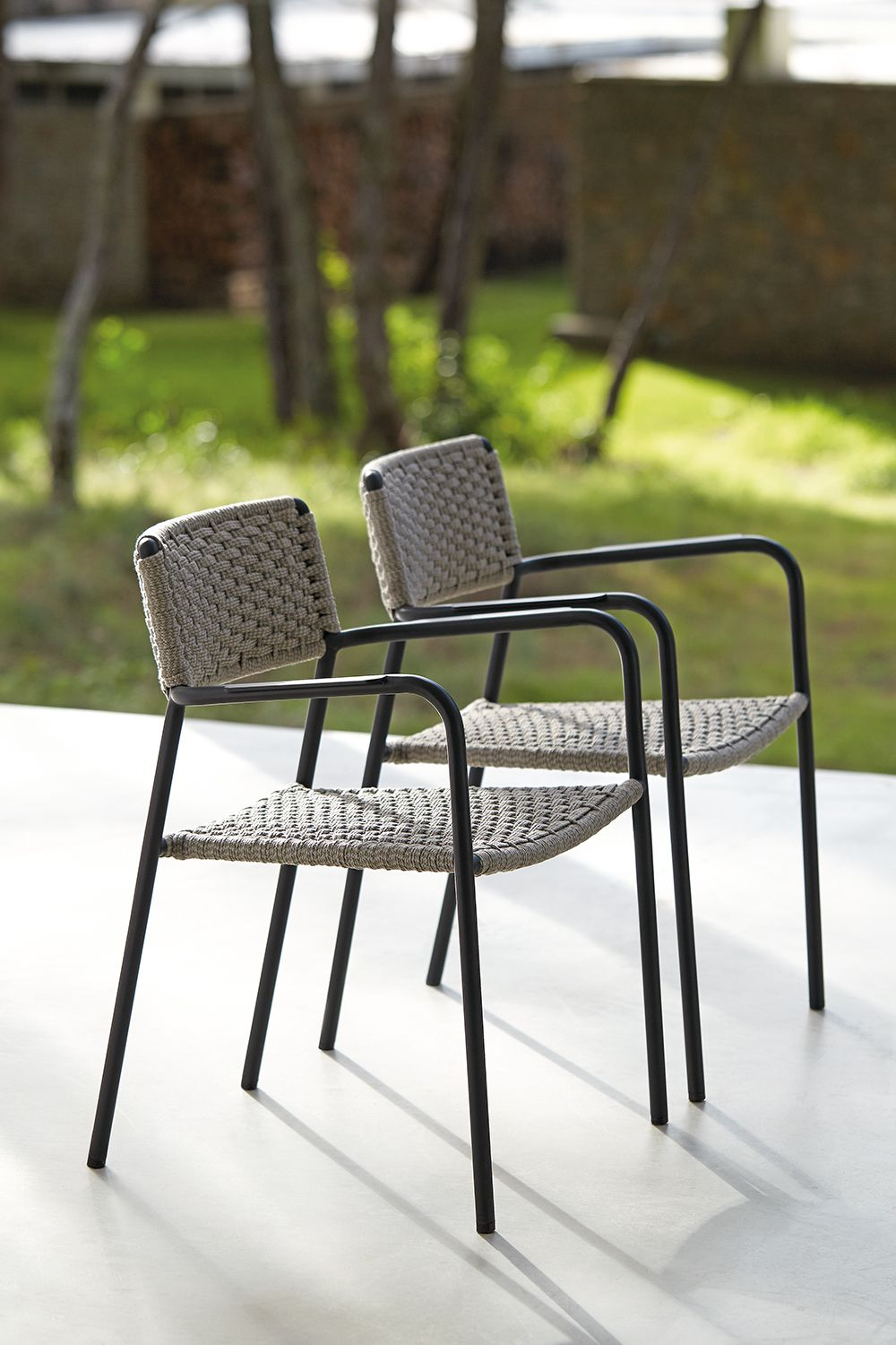 Outdoor dining chair by Manutti. Stackable, light, soft, weather resistant, rope, powdercoated aluminium. Pool, terrace, garden furniture. Belgian design.