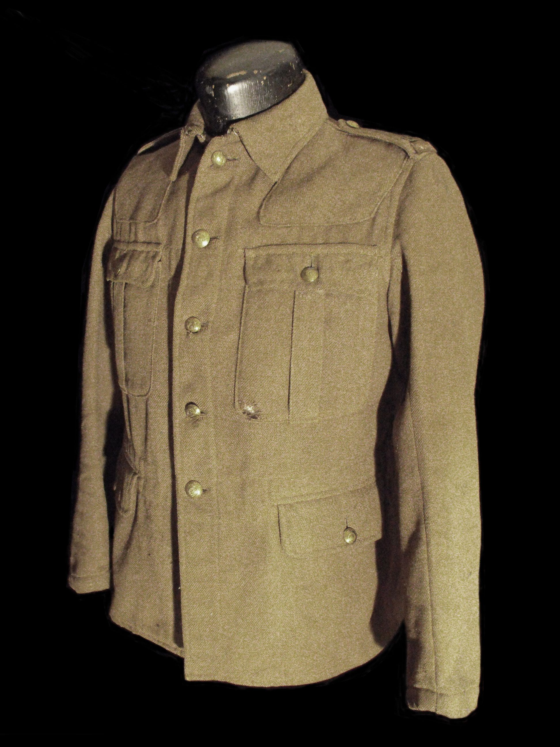 df23dfe97e6 WW1 Canadian Infantry Tunic with brass shoulder titles.
