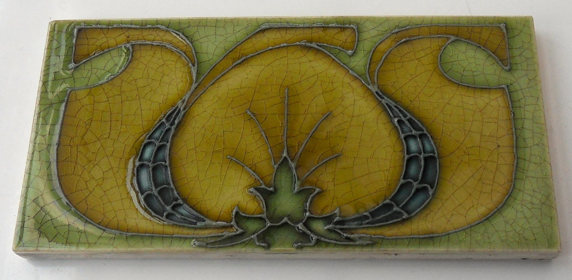 """One of the best tube-lined designs on a 6""""x3"""" tile from Pilkingtons c1906, tile reference 1162"""