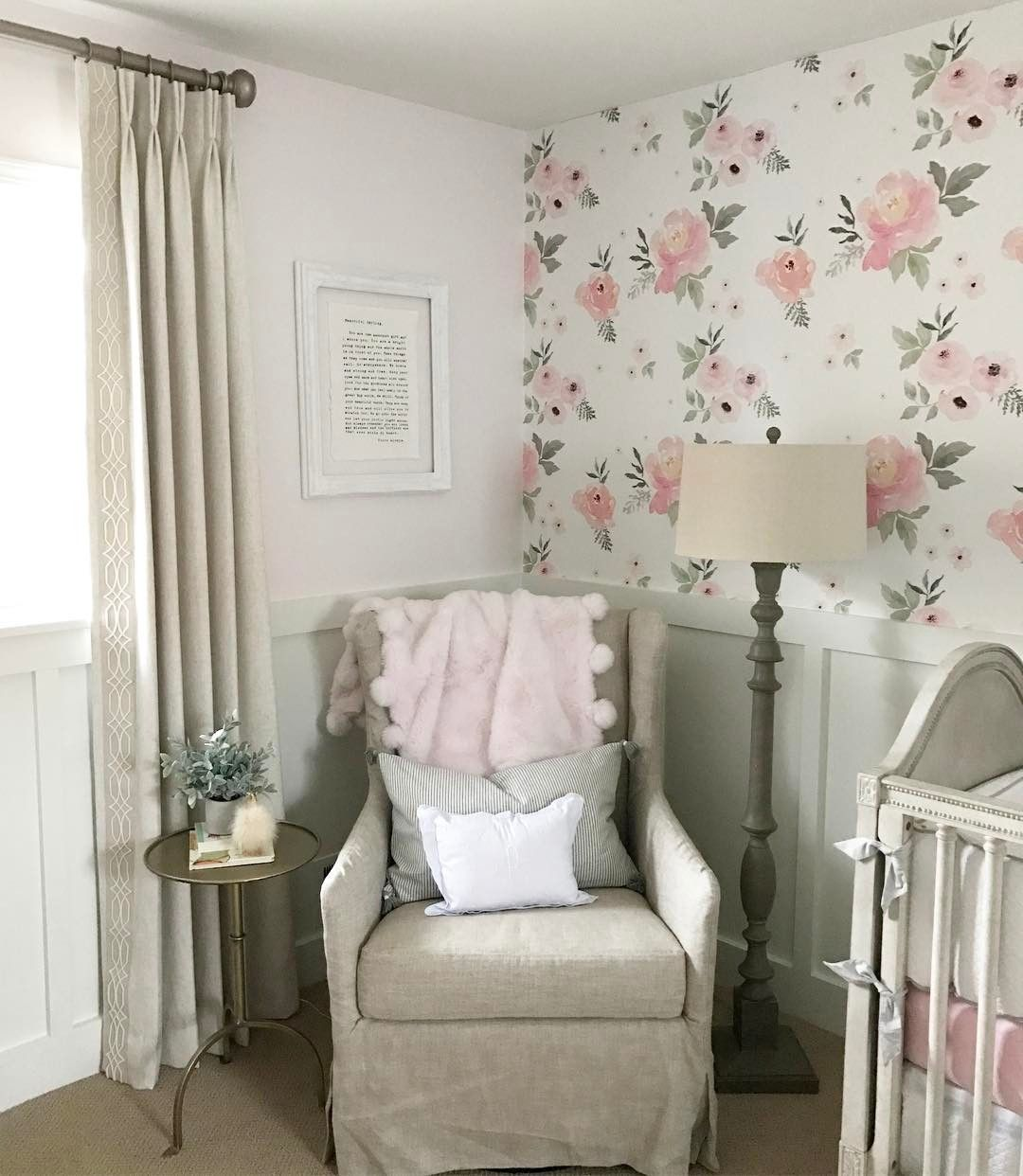 Beautiful Nursery with large floral wallpaper and