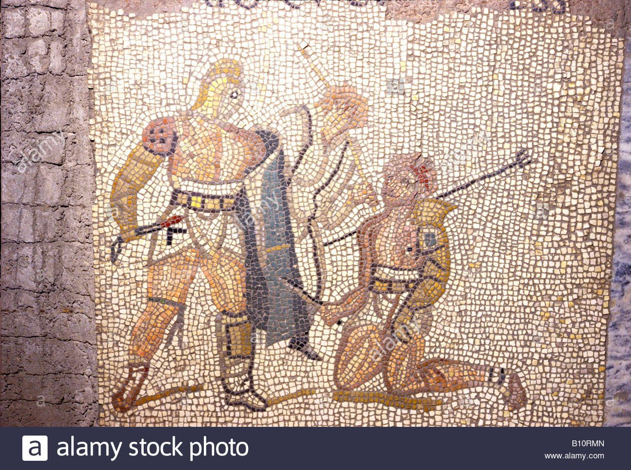 Download this stock image: Roman mosaic, Gladiators defeated Retarius kneels, Umpire behind. ©The Ancient Art & Architecture Collection Ltd. - B10RMN from Alamy's library of millions of high resolution stock photos, illustrations and vectors.