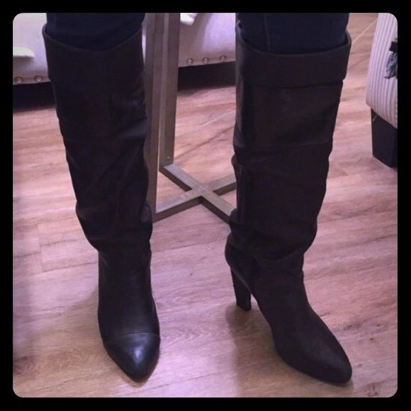 Genuine Leather Boots > Nine West Nine West genuine leather boots. Option to fold or unfold the top. Zipper on the inside of each boot. Soft leather allows the boots to scrunch. Wear and tear on the heel. Priced accordingly. Nine West Shoes Over the Knee Boots
