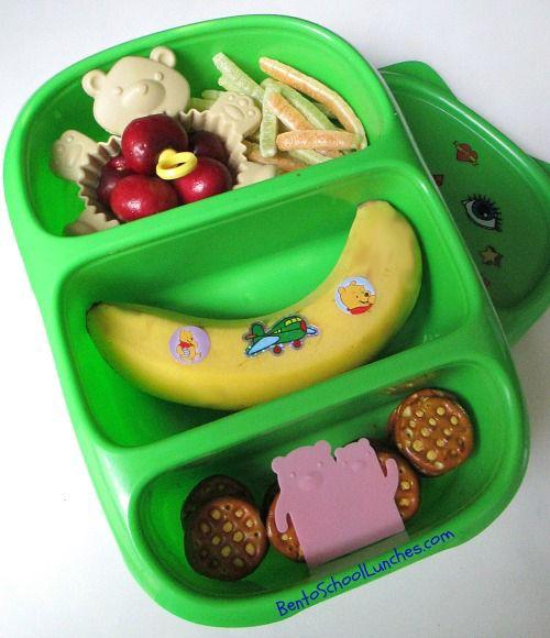 Snack bento: Cherries, veggie stix, banana, cheddar cheese pretzels.