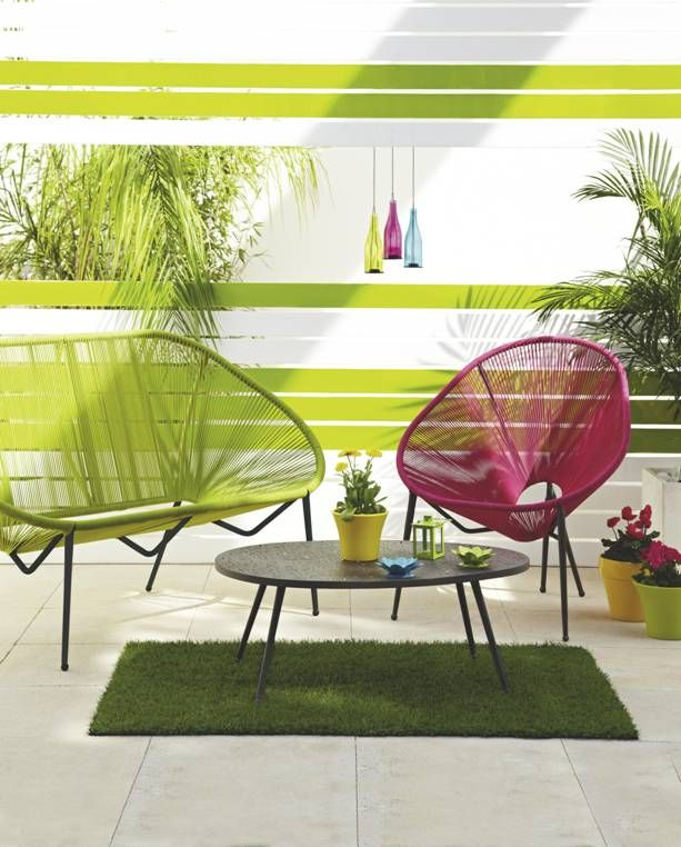 We love the vibrant Moretta armchair and bench - bringing a tropical vibe to any garden this summer. #gardenfurnture #lime #hotpink
