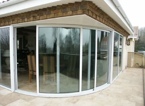 Curved glass patio doors and windows balcony systems patio curved glass patio doors and windows balcony systems planetlyrics Image collections