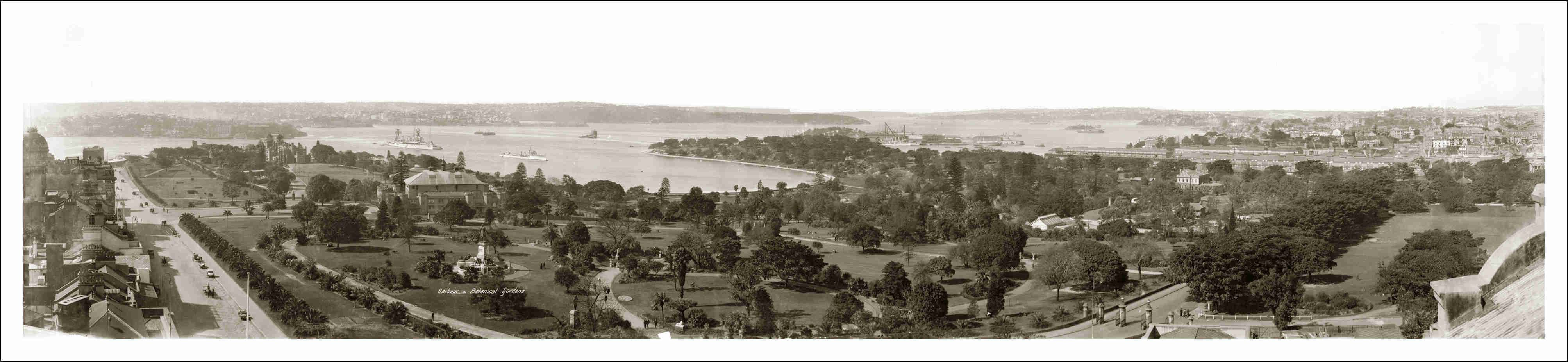 Harbour And Botanical Gardens - Sydney c 1920, from the Wyoming Building in Macquarie Street, from left, Macquarie Street, Bennelong Point, Government House, Conservatorium of Music, Warships in Harbour, Farm Cove, looking across Botanical Gardens, Mrs. Macquarie's Point, Garden Island as an island, Potts Point and The Domain.