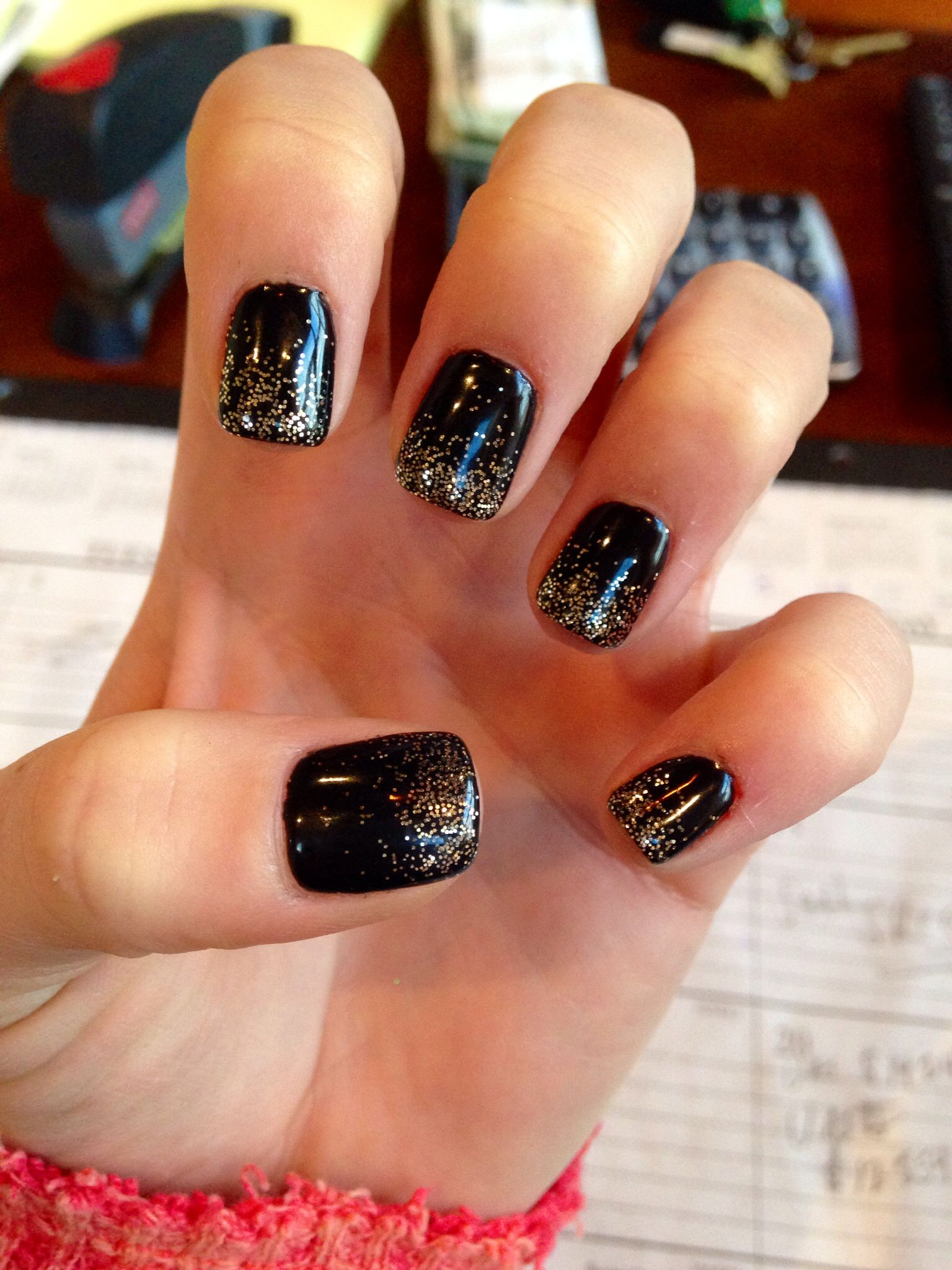 New Year's Eve nails. Black and gold sparkle Black gold