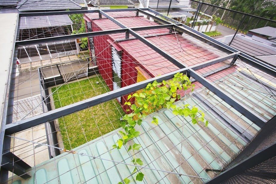 In Indonesia A Green Roofed Container Home Stands Up To The Heat By Container House Shipping Container Green Roof