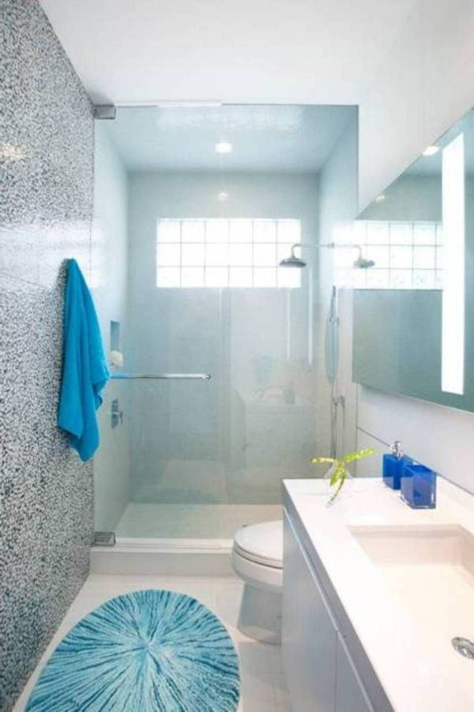 Small Bathroom Designs With Walk In Shower Glass Door And Blue Mat And Towes And Narrow Layout Narrow Bathroom Designs Simple Bathroom Small Bathroom Layout