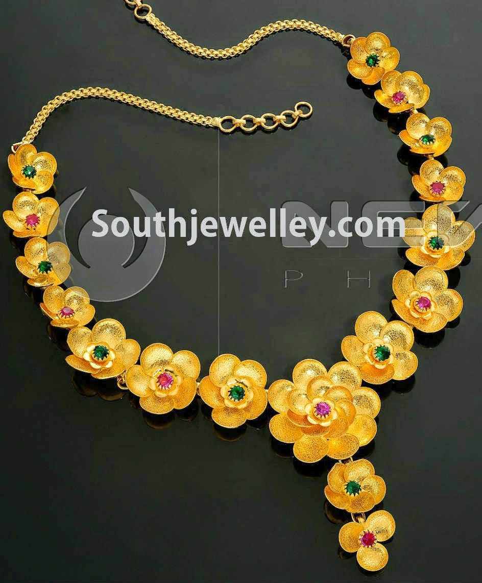 22 carat gold floral designer pendant with multiple beads chain and - Trendy Floral Gold Necklace With Flowers Arranged As A Garland And Studded With Rubies And Emeralds From Vaibhav Jewellers