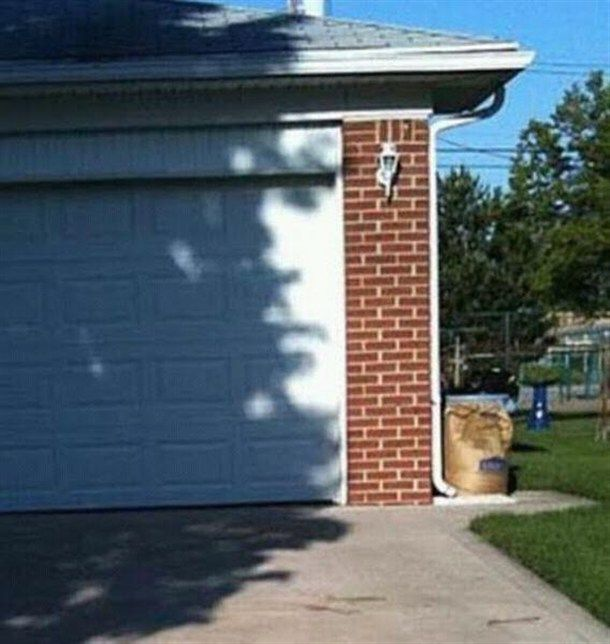 An illusion of a shadow looks like Jim Morrison's face on a garage door. Cool!
