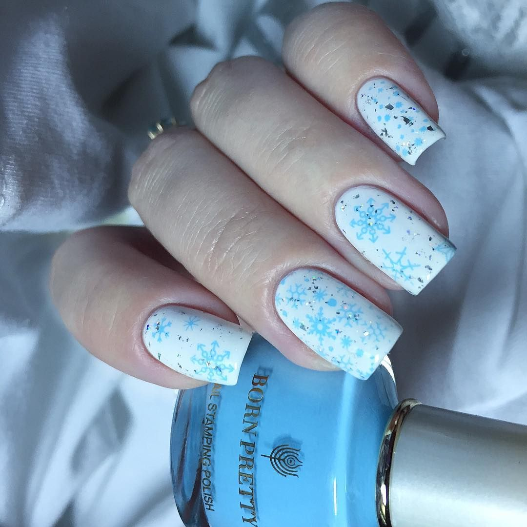 Pretty christmas snowflakes nails from liubanikanails