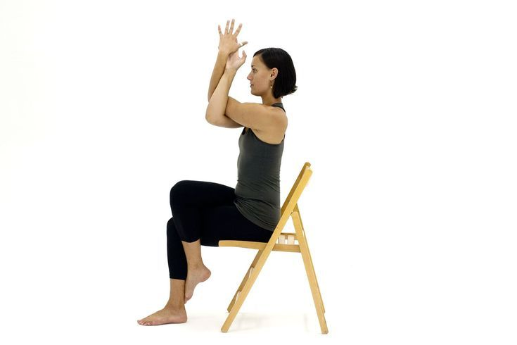 10 Yoga Poses You Can Do In A Chair Chair Yoga Chair Pose Yoga Yoga Information